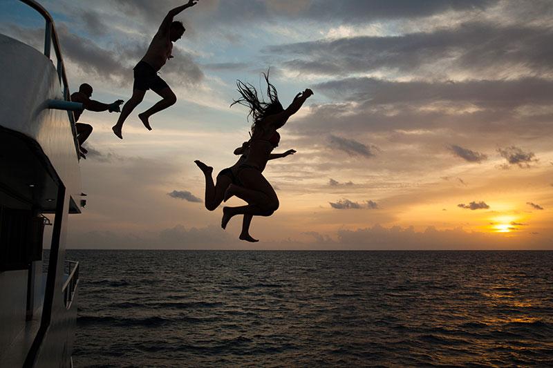 shesurfs.com.au - Mikala Wilbow - lifestyle photographer - Maldives boat jump